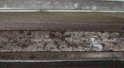 クリーニング前のルーバー(風向板) 神戸の天井カセット形エアコン4方向吹出