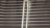 クリーニング前の熱交換器 神戸の天井カセット形エアコン4方向吹出